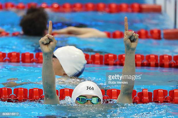 Wang Yinan of China celebrates winning the gold medal in the Men's 50m Freestyle S8 Final on day 9 of the Rio 2016 Paralympic Games at the Olympic...