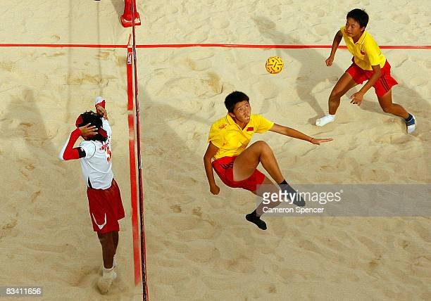 Wang Yu of China kicks the ball during the women's beach sepaktakraw match between China and Indonesia at Sanur Beach on October 23 2008 in Bali...