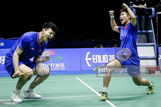 Wang Yulyu and Huang Dongping of China celebration win the game after winning the mixed doubles final match against He Jiting and Duyue at the 2019...