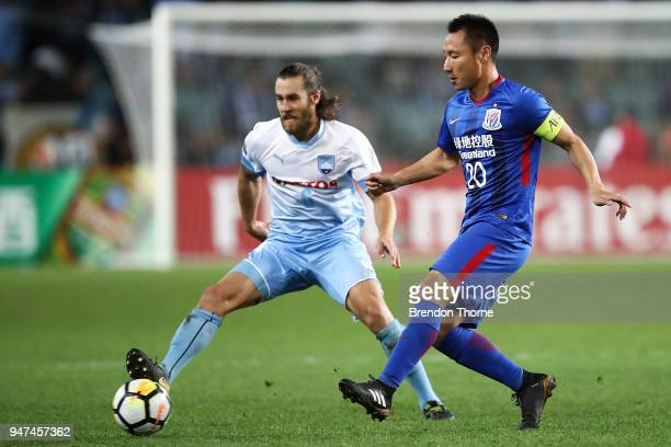 Wang Yun of Shanghai Shenhua FC passes the ball to a team mate during the AFC Champions League match between Sydney FC and Shaghai Shenhua at Sydney...