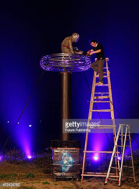 Wang Zengxiang does a thorough check on the metal equipment before playing music with manmade lightening during a show on April 29 2015 in Changle...
