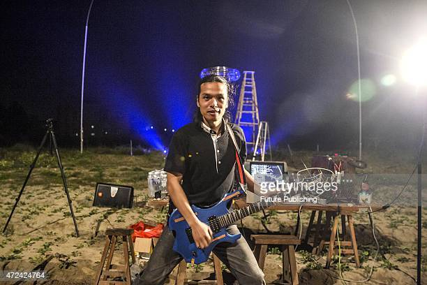 Wang Zengxiang poses with a special guitar which is used to induce manmade lightening during a show on April 29 2015 in Changle China Former...