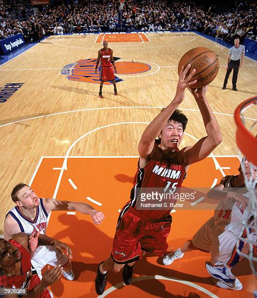 Wang Zhizhi of the Miami Heat goes up for a shot during the NBA game against the New York Knicks at Madison Square Garden on January 24 2004 in New...