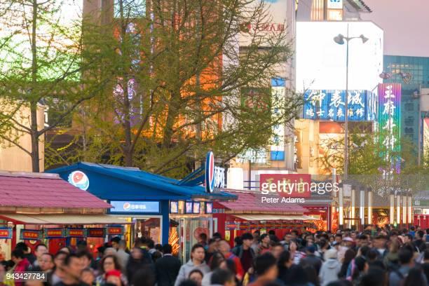 wangfujing shopping street at dusk, beijing, china - peter adams stock pictures, royalty-free photos & images