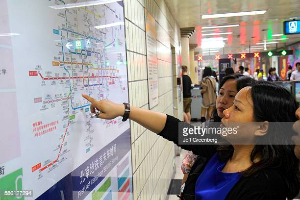 Wangfujing Subway Station Line 1 Asian woman rider looking at route map