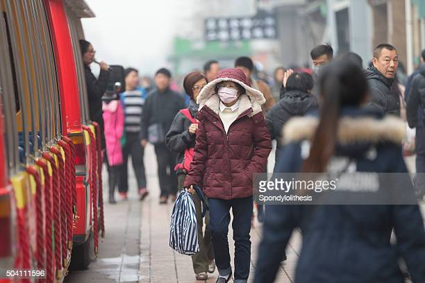 wangfujing walking street in Œbeijing,china - chinese mask stock photos and pictures