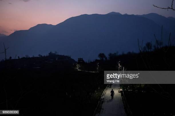 Wangguocheng 54 from Qiang walks on the path on March 28 2018 in Wenchuan County Radish village Ngawa Tibetan and Qiang Autonomous Prefecture Sichuan...