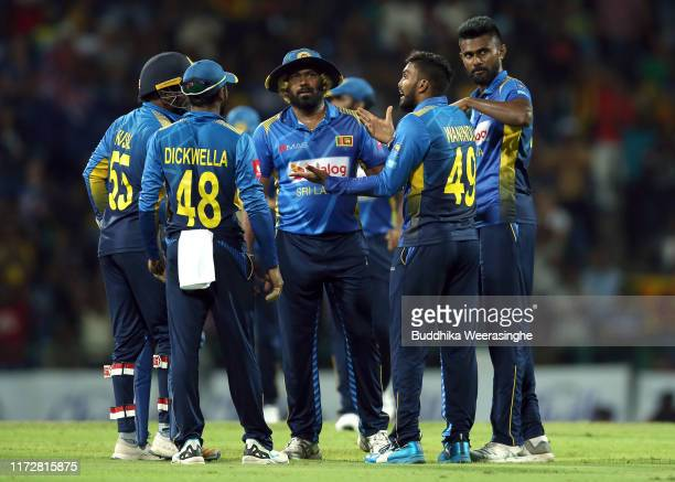 Wanidu Hasaranga of Sri Lanka celebrates with his team mate after taking the wicket of New Zealand's Todd Astle during the Twenty20 International...