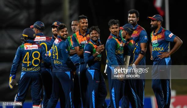 Wanindu Hasaranga , Dushmantha Chameera , Akila Dananjaya , Ashen Bandara , Thisara Perera and Nuwan Pradeep of Sri Lanka celebrate the dismissal of...