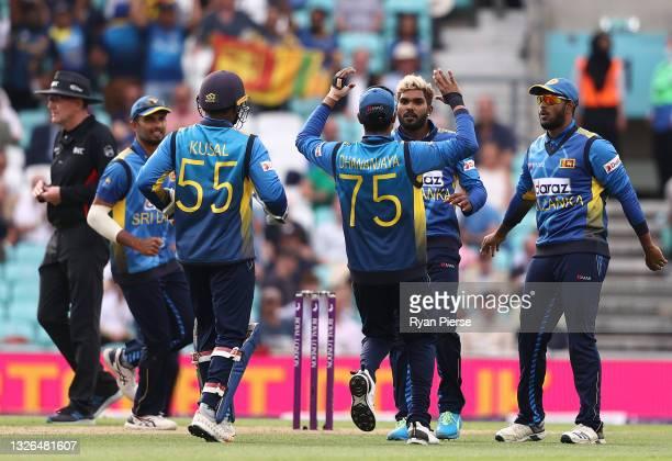 Wanindu Hasaranga of Sri Lanka celebrates after taking the wicket of Jonny Bairstow of England during the 2nd One Day International match between...