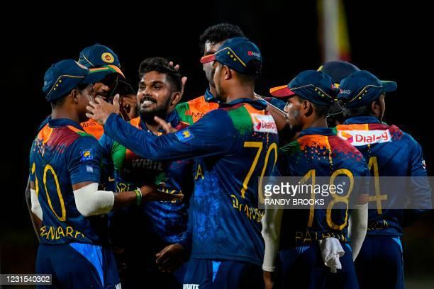 Wanindu Hasaranga of Sri Lanka celebrates the dismissal of Chris Gayle of West Indies during the 2nd T20i match between Sri Lanka and West Indies at...