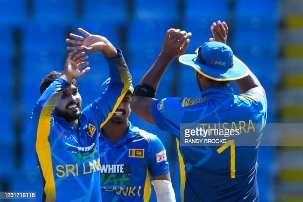 Wanindu Hasaranga of Sri Lanka celebrates the dismissal of Jason Mohammed of West Indies during the 3rd and final ODI match between West Indies and...