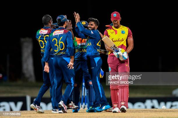 Wanindu Hasaranga of Sri Lanka celebrates the dismissal of Lendl Simmons of West Indies during the 3rd and final T20i match between Sri Lanka and...