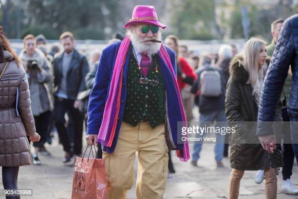 Wanny Antonio Di Filippo wearing pink hat and scarf is seen during the 93 Pitti Immagine Uomo at Fortezza Da Basso on January 10 2018 in Florence...