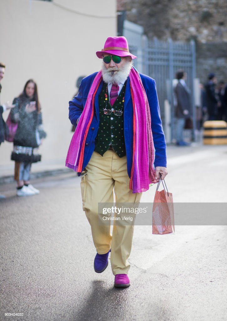 Wanny Antonio Di Filippo wearing pink hat and scarf is seen during the 93. Pitti Immagine Uomo at Fortezza Da Basso on January 10, 2018 in Florence, Italy.