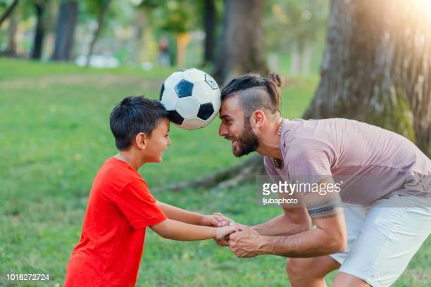 i want to be great at soccer like my dad - forehead stock pictures, royalty-free photos & images