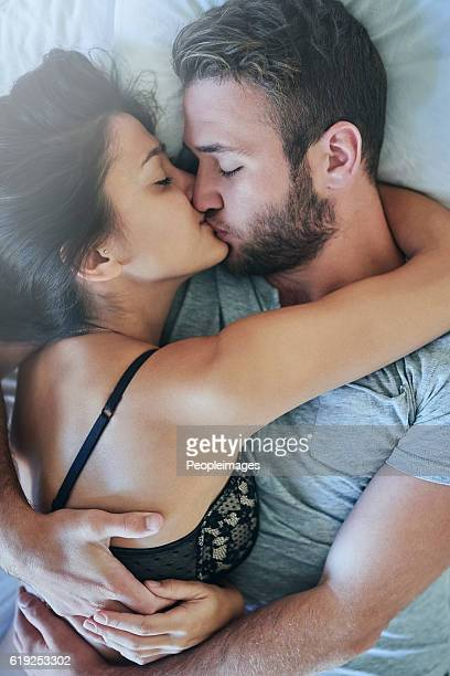i want to cuddle all day! - couple and kiss and bedroom stock photos and pictures