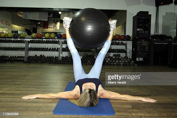 Want washboard abs lie on a mat with your arms extended out and palms facing down With your legs in the air directly over your hips position a...