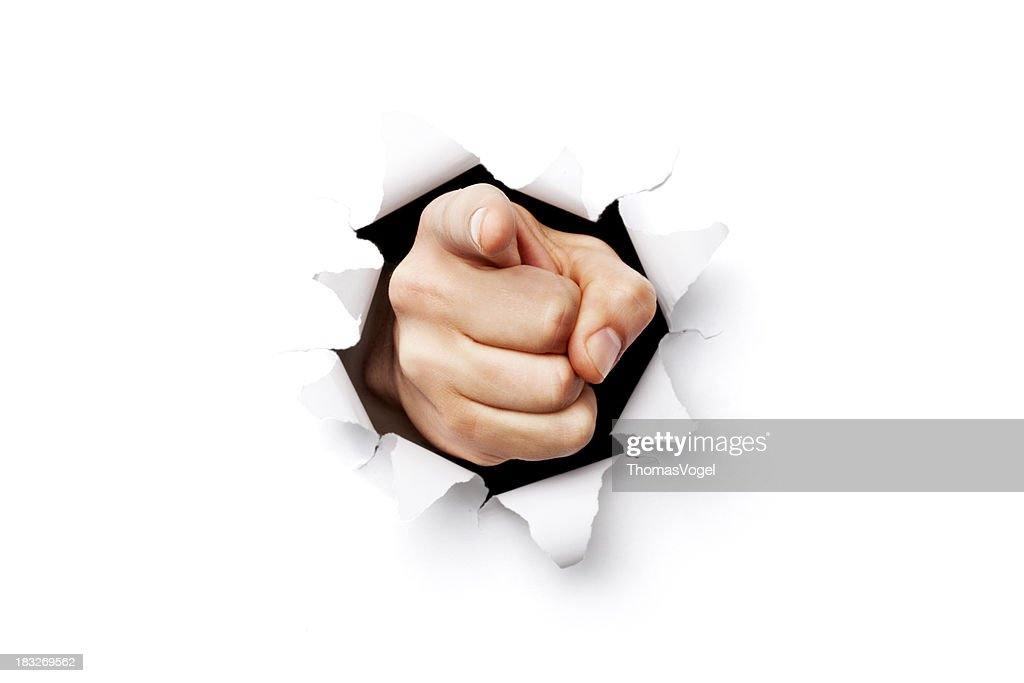 I want you finger coming through torn paper : Stock Photo