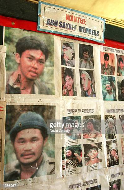Wanted photos of members of Abu Sayyaf a guerrilla band the US has linked to Saudiborn dissident Osama bin Laden and the alQaeda are posted April 29...