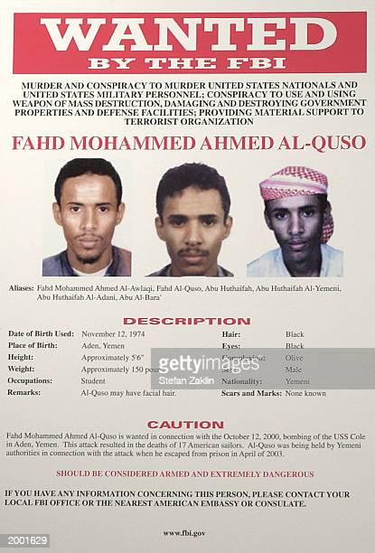 A wanted poster for Fahd Mohammed Ahmed AlQuso isssued by the Federal Bureau of Investigations is seen at FBI headquarters May 15 2003 in Washington...