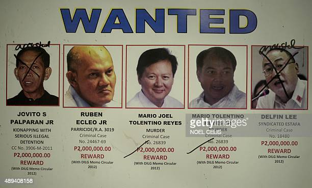 A wanted poster shows the picture of brothers Joel Reyes and Mario Reyes in Manila on September 21 2015 The two Philippine politicians wanted over...