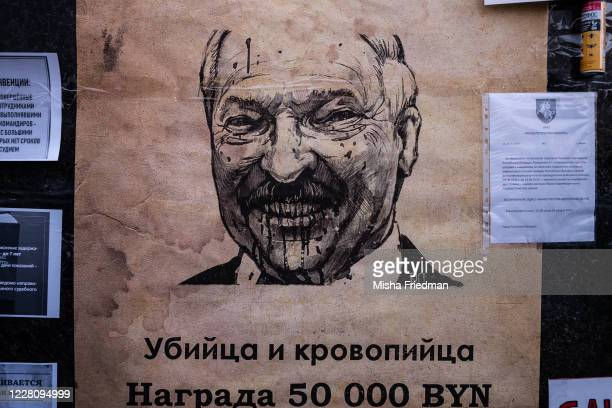 Wanted poster with an image of Belarus President Aleksandr Lukashenko is displayed as demonstrators participate in an anti-Lukashenko rally on August...
