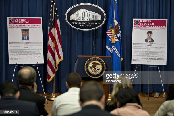 Wanted posters for Igor Anatolyevich Sushchin right and Dmitry Aleksandrovich Dokuchaev sit on display before a news conference at the Department of...
