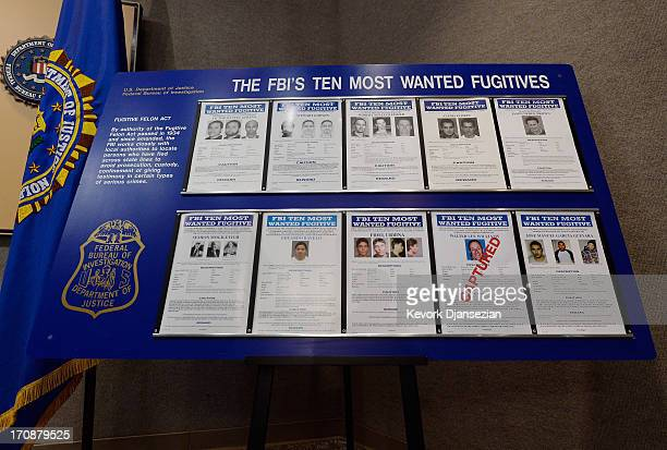 Wanted posters of former USC professor Walter Lee Williams are displayed during a news conference by Los Angeles Police Department Assistant Chief...