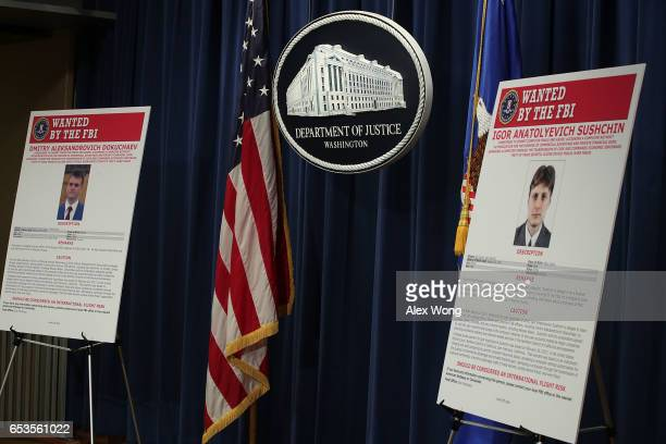 Wanted posters of Russian national and residents Igor Anatolyevich Sushchin and Dmitry Aleksandrovich Dokuchaev are on display prior to a news...