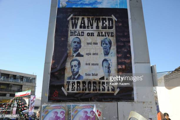Wanted style poster showing president Barack ObamaAngela Merkel Nicolas Sarkoy and David Cameron labeled as a terrorists is displayed on a billboard...