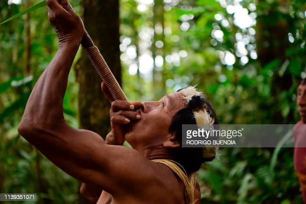 TOPSHOT Waorani indigenous Tiri Nenquimo uses a blowpipe near the village of Nemompare on the banks of the Curaray river in Pastaza province Ecuador...