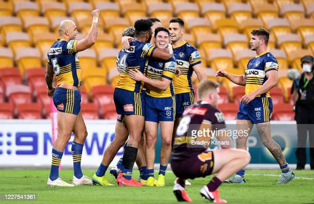 Waqa Blake and Mitchell Moses of the Eels celebrate a try during the round three NRL match between the Brisbane Broncos and the Parramatta Eels at...