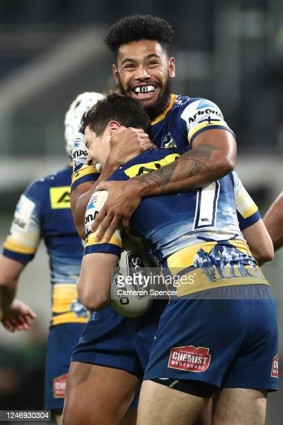 Waqa Blake and Mitchell Moses of the Eels celebrate a try to Kane Evans of the Eels during the round four NRL match between the Parramatta Eels and...