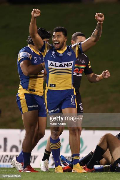 Waqa Blake of the Eels celebrates a try scores by Isaiah Papali'i of the Eels during the round 16 NRL match between the Penrith Panthers and the...