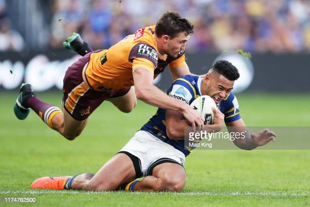 Waqa Blake of the Eels is tackled by Corey Oates of the Broncos during the NRL Elimination Final match between the Parramatta Eels and the Brisbane...