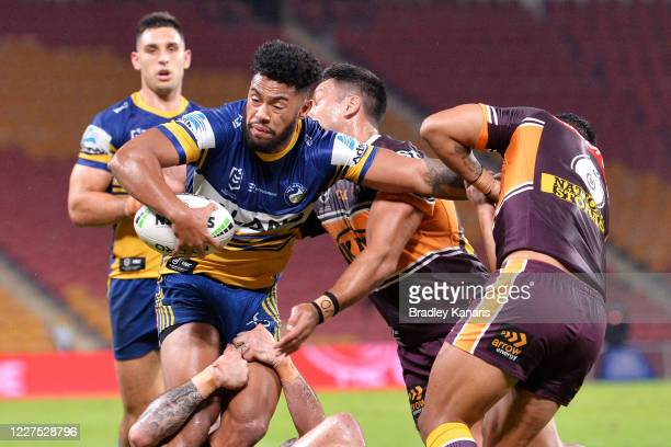 Waqa Blake of the Eels is tackled during the round three NRL match between the Brisbane Broncos and the Parramatta Eels at Suncorp Stadium on May 28...