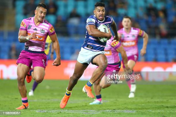 Waqa Blake of the Eels makes a break to score a try during the round 22 NRL match between the Gold Coast Titans and the Parramatta Eels at Cbus Super...