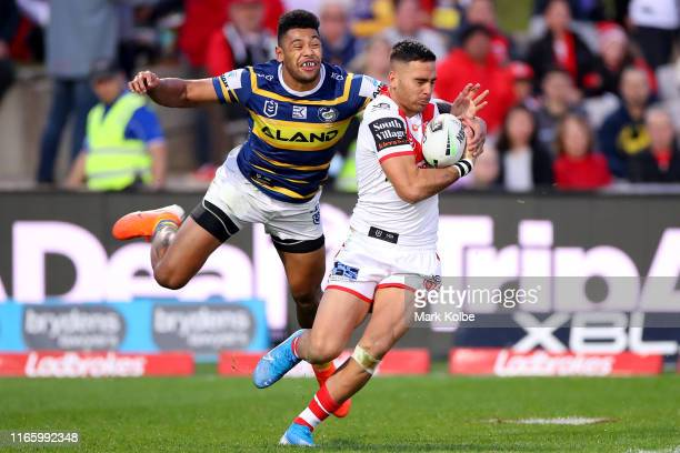 Waqa Blake of the Eels tackles Corey Norman of the Dragons during the round 20 NRL match between the St George Illawarra Dragons and the Parramatta...