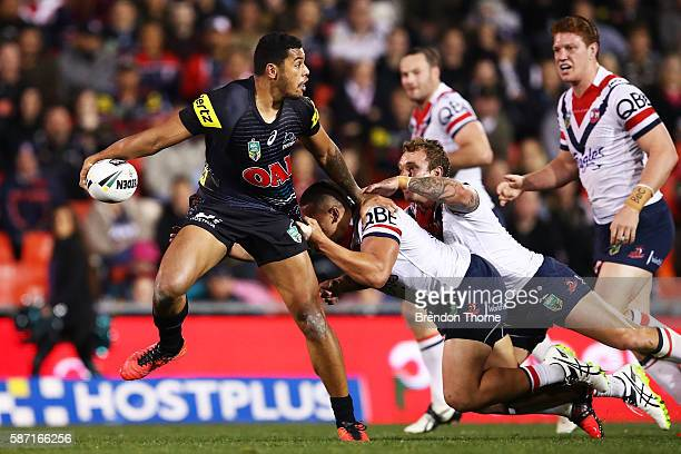 Waqa Blake of the Panthers breaks the Roosters defence during the round 22 NRL match between the Penrith Panthers and the Sydney Roosters at Pepper...