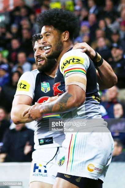 Waqa Blake of the Panthers celebrates a try with Josh Mansour of the Panthers during the round 25 NRL match between the Melbourne Storm and the...