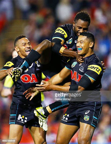 Waqa Blake of the Panthers celebrates his try with Apisai Koroisau and James Segeyaro during the round six NRL match between the Penrith Panthers and...