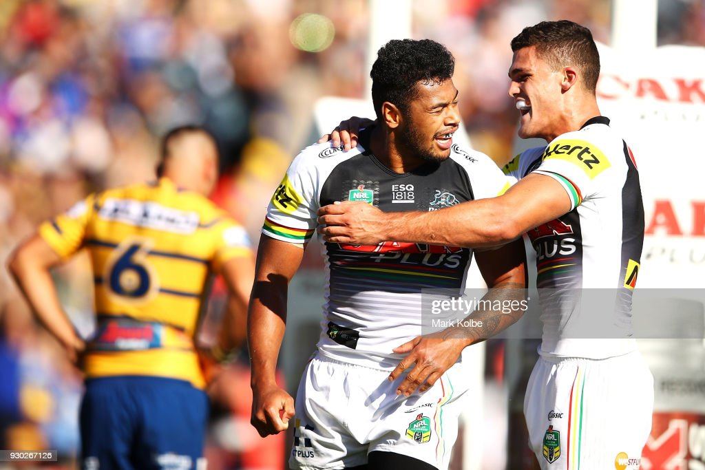 Waqa Blake of the Panthers celebrates with his team mate Nathan Cleary of the Panthers after scoring a try during the round one NRL match between the Penrith Panthers and the Parramatta Eels at Panthers Stadium on March 11, 2018 in Sydney, Australia.