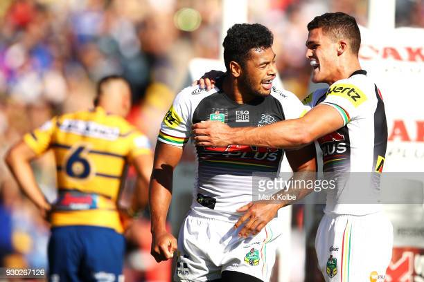 Waqa Blake of the Panthers celebrates with his team mate Nathan Cleary of the Panthers after scoring a try during the round one NRL match between the...