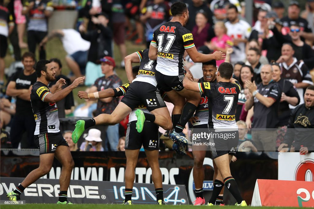 Waqa Blake of the Panthers celebrates with his team mates after scoring a try during the round 10 NRL match between the Penrith Panthers and the New Zealand Warriors at Pepper Stadium on May 13, 2017 in Sydney, Australia.