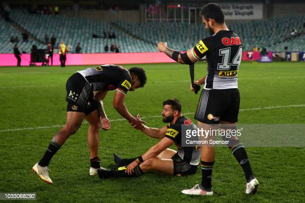 Waqa Blake of the Panthers consoles Josh Mansour of the Panthers after losing the NRL Semi Final match between the Cronulla Sharks and the Penrith...