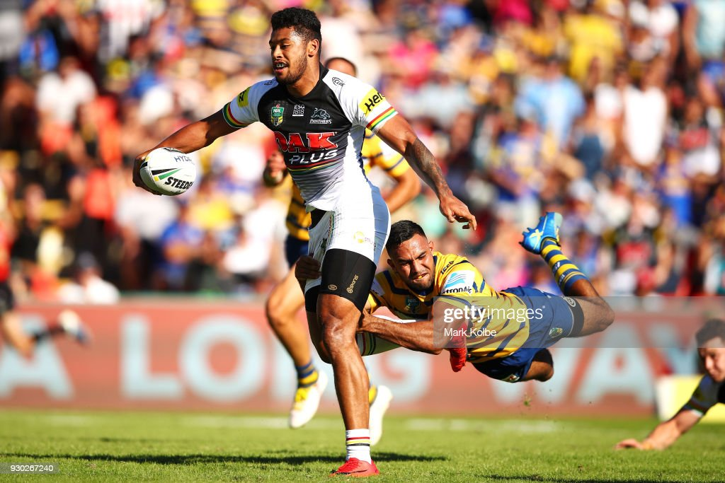 Waqa Blake of the Panthers evades the tackle of Bevan French of the Eels on his way to scoring a try during the round one NRL match between the Penrith Panthers and the Parramatta Eels at Panthers Stadium on March 11, 2018 in Sydney, Australia.