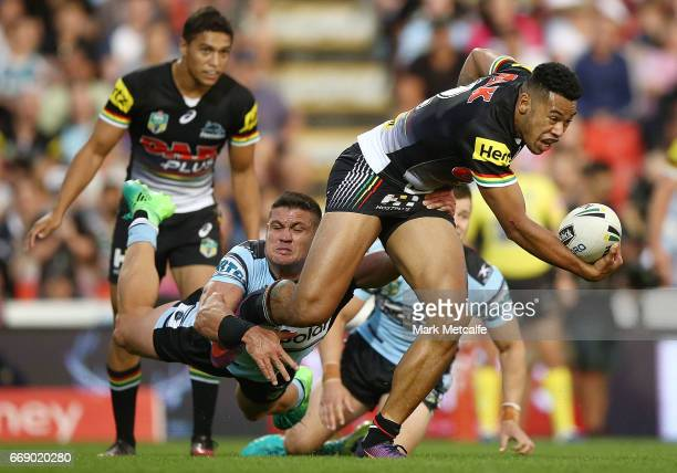 Waqa Blake of the Panthers is tackled by Chris Heighington of the Sharks during the round seven NRL match between the Penrith Panthers and the...