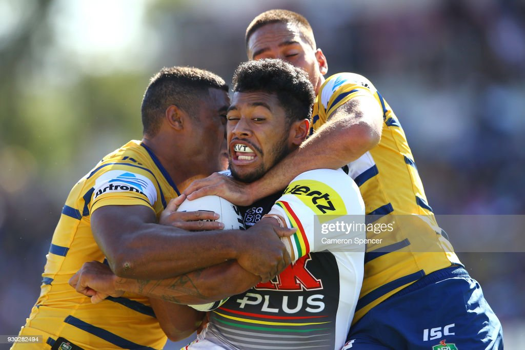 Waqa Blake of the Panthers is tackled during the round one NRL match between the Penrith Panthers and the Parramatta Eels at Panthers Stadium on March 11, 2018 in Sydney, Australia.
