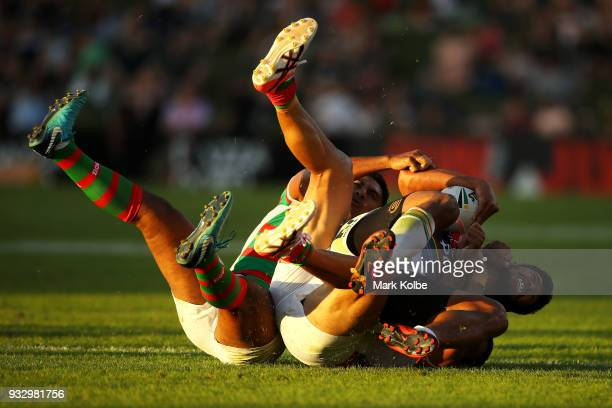 Waqa Blake of the Panthers is tackled during the round two NRL match between the Penrith Panthers and the South Sydney Rabbitohs at Penrith Stadium...